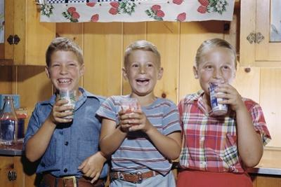Happy Children Enjoying Glass of Cold Milk by William P. Gottlieb