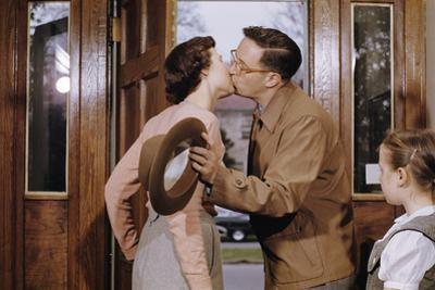 Husband and Wife Kissing Goodbye by William P. Gottlieb