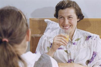 Mother Enjoying Glass of Orange Juice in Bed by William P. Gottlieb