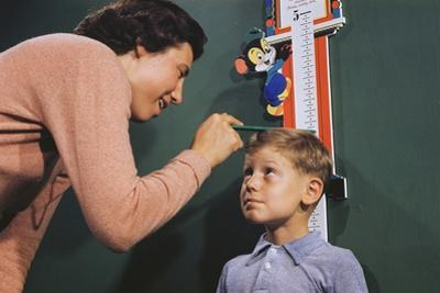 Mother Measuring Boy's Height by William P. Gottlieb
