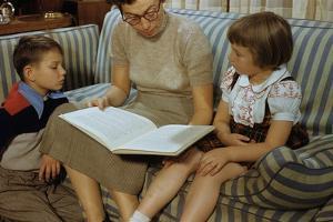 Mother Reading Book to Children by William P. Gottlieb