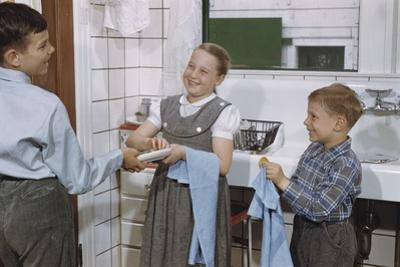Siblings Drying Dishes by William P. Gottlieb