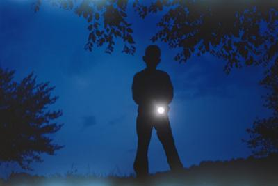 Silhouette of Boy Holding Flashlight by William P. Gottlieb