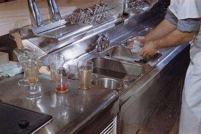 Washing Glasses at Diner by William P. Gottlieb