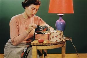 Woman Darning Socks by William P. Gottlieb