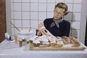 Woman Decorating Cup Cakes by William P. Gottlieb