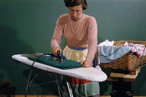 Woman Ironing at Home by William P. Gottlieb
