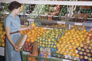 Woman Shopping at Grocery Store by William P. Gottlieb