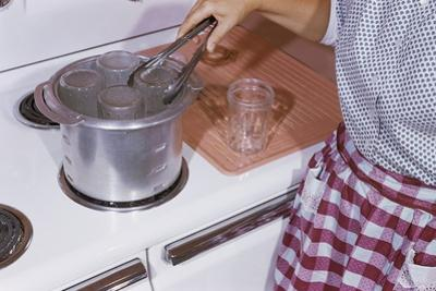 Woman Sterilizing Jars for Canning
