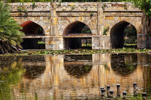 Athpula Eight Piers Stone Bridge, Reflection of Lodi Gardens, New Delhi, India by William Perry