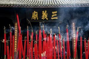 Burning Incense in the Temple of Three Kingdoms, Wuhou Memorial, Chengdu, Sichuan, China by William Perry