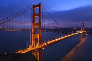 Golden Gate Bridge Sunset Pink Skies Evening with Lights of San Francisco, California in Background by William Perry