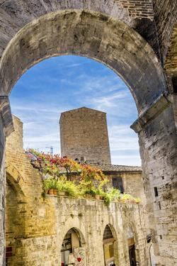 Medieval stone arch and tower, San Gimignano, Tuscany, Italy. by William Perry