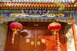 Ornate red door, lanterns New Year sayings, Hutong Neighborhood, Beijing, China. by William Perry
