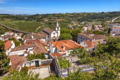Santa Maria Church in Medieval Town, Obidos, Portugal. by William Perry