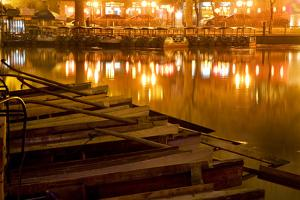 Wooden Boats on Houhai Lake with Lights of Bars and Restaurants in Background, Beijing, China by William Perry