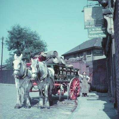 Horse-Drawn Wagon Filled with Beer Barrels at a Bar Along the Thames