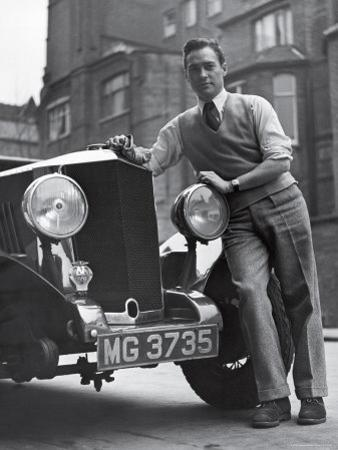 Richard Todd Leaning on Front of Car