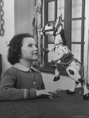 Young Child Starring at Marionette Muffin the Mule
