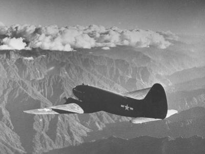 """American C-46 Transport Flying """"The Hump"""" a Long, Difficult Flight over the Himalayas"""