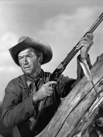 https://imgc.allpostersimages.com/img/posters/winchester-73-by-anthonymann-with-james-stewart-1950-b-w-photo_u-L-Q1C2ISE0.jpg?artPerspective=n