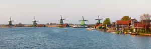 Windmills along the Zaan River at Zaanse Schans, Zaandam, North Holland, Netherlands
