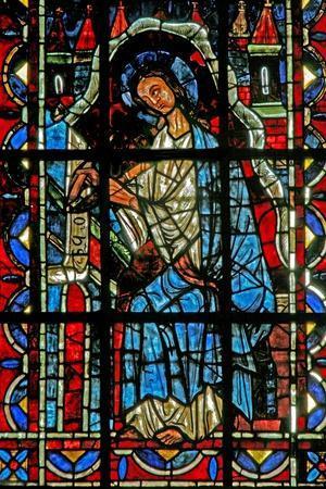 https://imgc.allpostersimages.com/img/posters/window-w202-depicting-st-john-writing-the-gospel_u-L-PRBZKF0.jpg?p=0