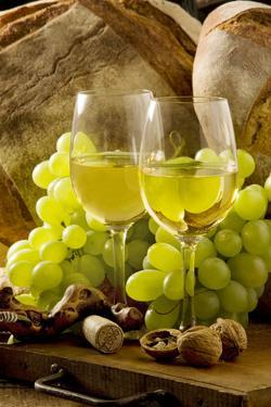 Wine Glasses with White Wine and Grapes