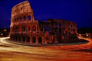 Traffic races around the ruins of the Colosseum. by Winfield Parks