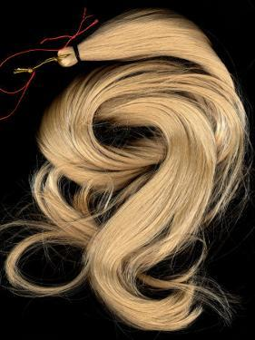 A Lock of Blonde Synthetic Hair by Winfred Evers