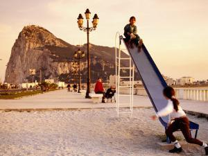 Playground at Bay of Algeciras with Rock of Gibraltar in Background, Andalucia, Spain by Witold Skrypczak