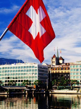 Swiss Flag on Mont Blanc Bridge with Quai General Guisan in Background, Geneva, Switzerland