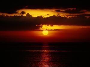 Sunset at Anilao by Wolcott Henry