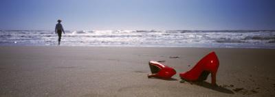 Woman and High Heels on Beach, California, USA