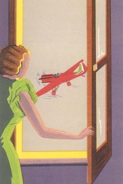 Woman at Window Watching Airplane