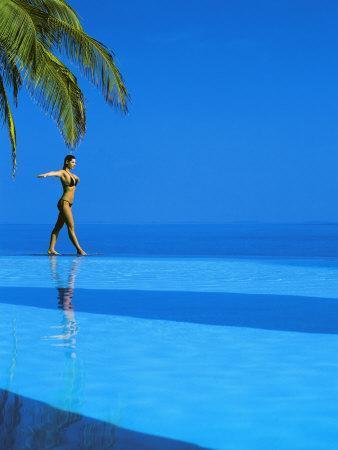https://imgc.allpostersimages.com/img/posters/woman-balancing-on-edge-of-infinity-pool-maldives-indian-ocean_u-L-P7X88K0.jpg?p=0