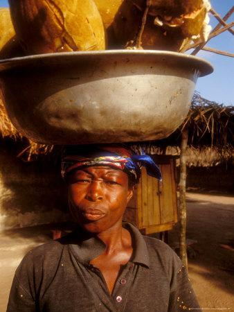 https://imgc.allpostersimages.com/img/posters/woman-carrying-pan-filled-with-baobab-fruit-boku-ghana_u-L-P5859W0.jpg?p=0