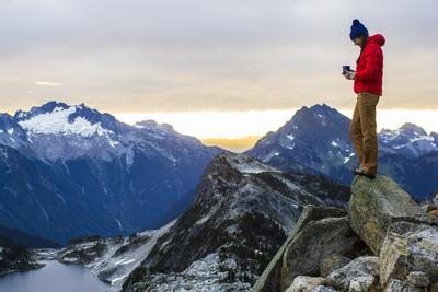 https://imgc.allpostersimages.com/img/posters/woman-drinks-her-morning-coffee-on-top-of-a-mountain-in-the-north-cascades_u-L-Q1BAOBE0.jpg?p=0
