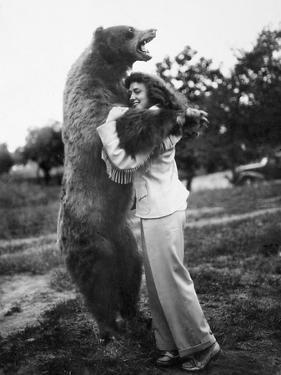 Woman Embraces a Stuffed Bear, Ca. 1940