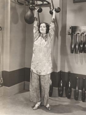 Woman Exercising in Silk Pajamas