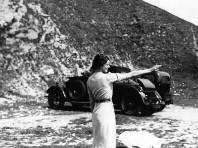 https://imgc.allpostersimages.com/img/posters/woman-firing-a-revolver_u-L-Q1077PJ0.jpg?artPerspective=n