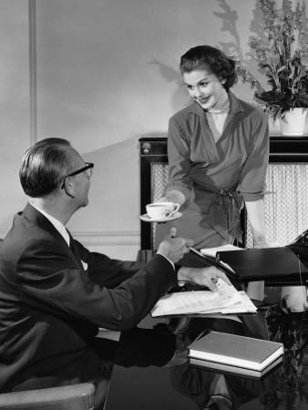 Woman Giving Cup To Man