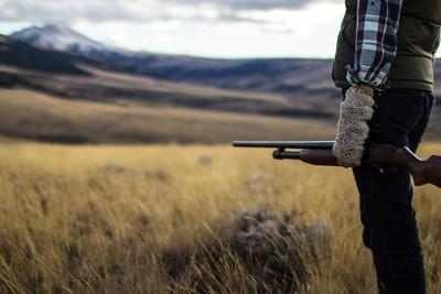 https://imgc.allpostersimages.com/img/posters/woman-hold-her-shotgun-while-out-bird-hunting-in-montana_u-L-Q1BASV90.jpg?p=0