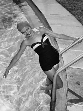Woman in Swimming Pool Posing on Steps