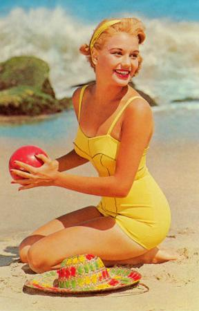 Woman in Yellow Bathing Suit with Ball