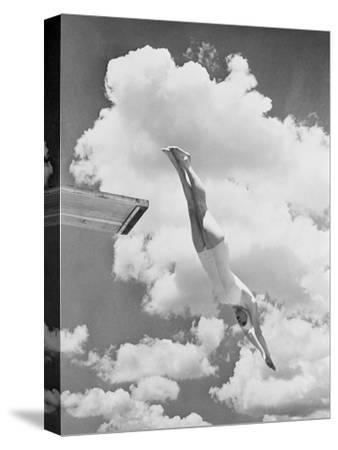 Woman jumping from springboard