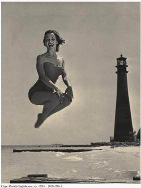 Woman Jumping in Front of Cape Florida Lighthouse, C.1975