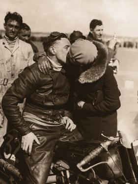 Woman Kissing Motorcycle Racer