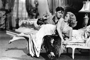 Woman Laid on the Kneel of a Man Have Her Bottom Smacked, 40'S