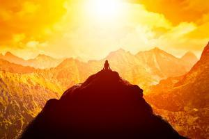 Woman Meditating in Sitting Yoga Position on the Top of a Mountains above Clouds at Sunset. Zen, Me